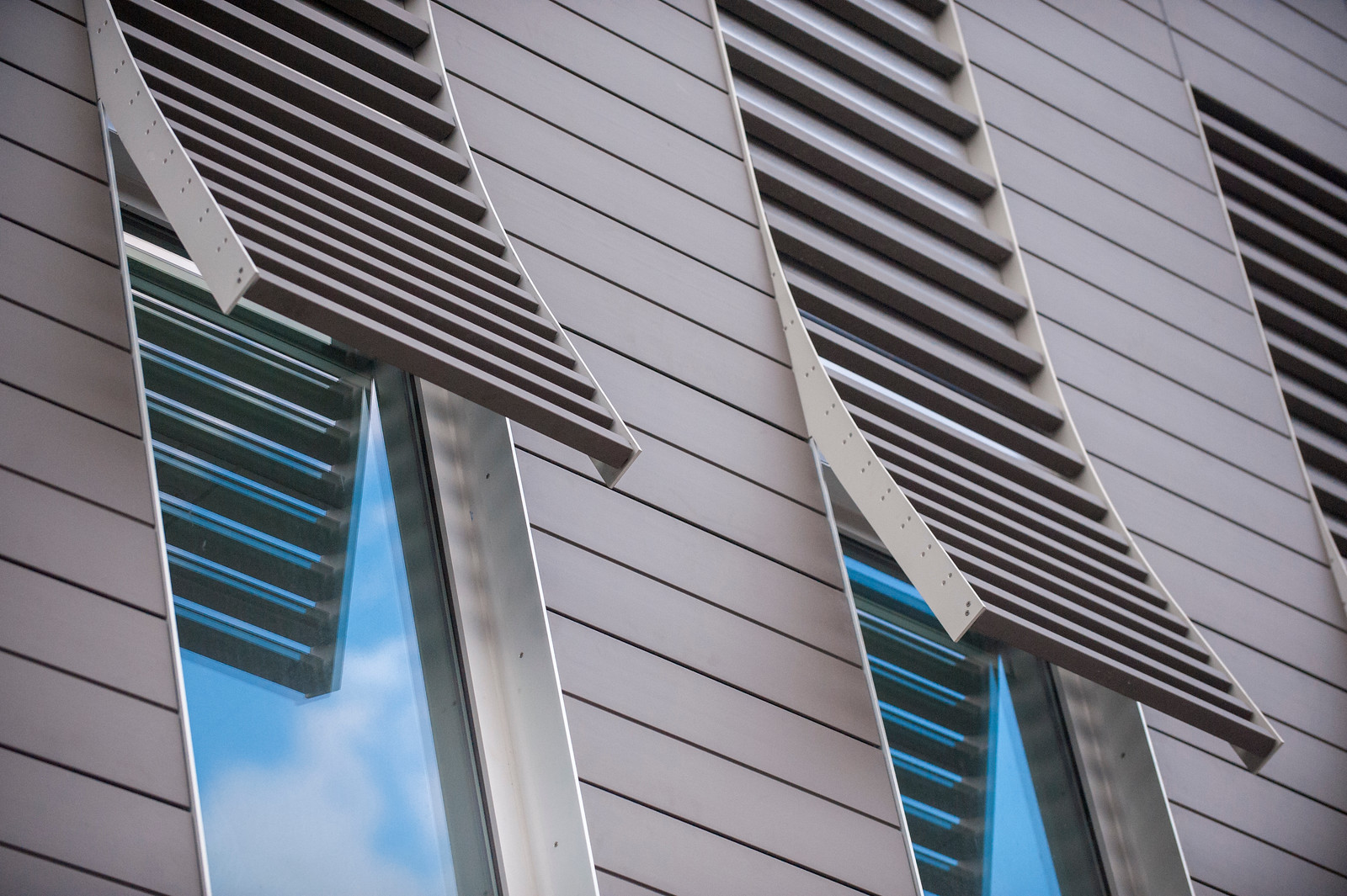 Windows on the Psychological and Brain Sciences Building with slats