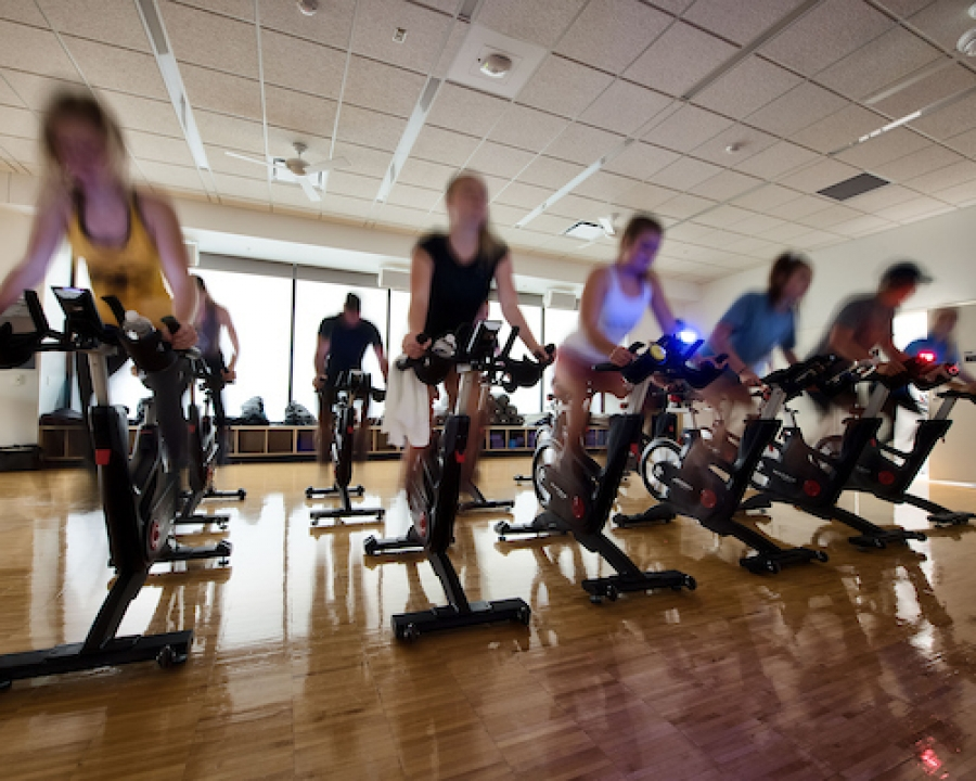Stationary bike riders in CRWC group fitness class