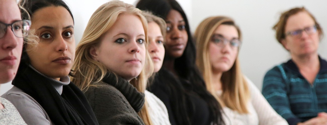 Group of diverse students listening to a presentation