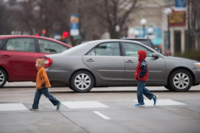 Kids in a crosswalk crossing street